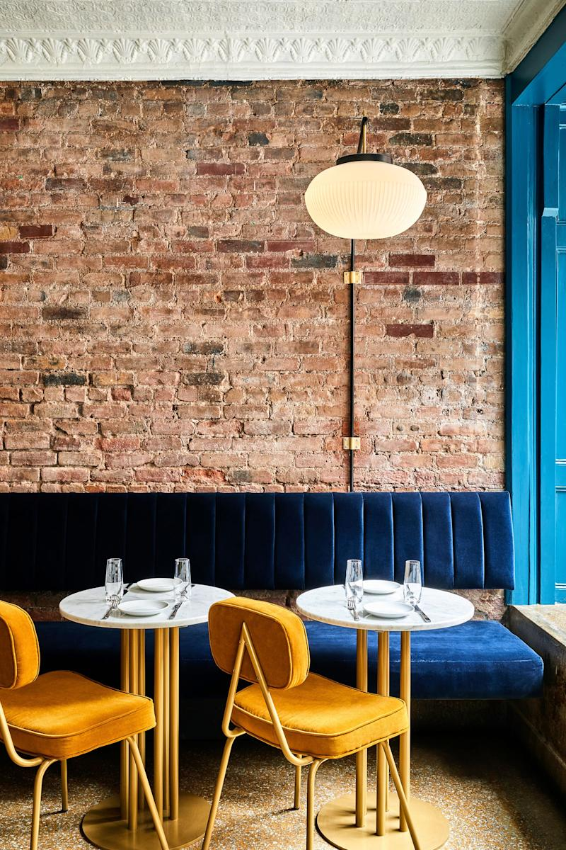 A classic (and easy) color to pair with yellow is blue. They are in opposite quadrants on the color wheel, making them pretty close to complementary. The tinge of orange in these vintage chairs brings the complement even closer.