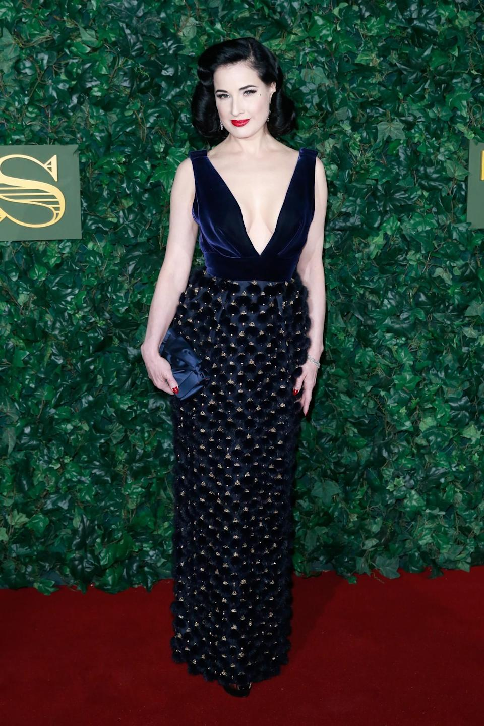 <p>Dita continued with her usual glamorous look in a velvet embellished dress and gorgeous red lips. <i>[Photo: Getty]</i> </p>