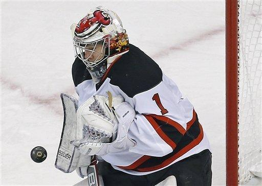 New Jersey Devils goalie Johan Hedberg makes a save during the first period of an NHL hockey game against the Boston Bruins in Boston, Tuesday, Jan. 29, 2013. (AP Photo/Charles Krupa)