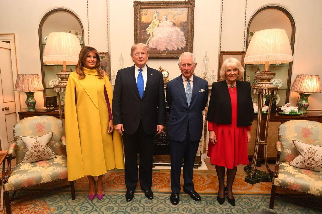 <p>Melania Trump chose a yellow cape dress and pink heels to meet with Prince Charles and Camilla, Duchess of Cornwall. </p>