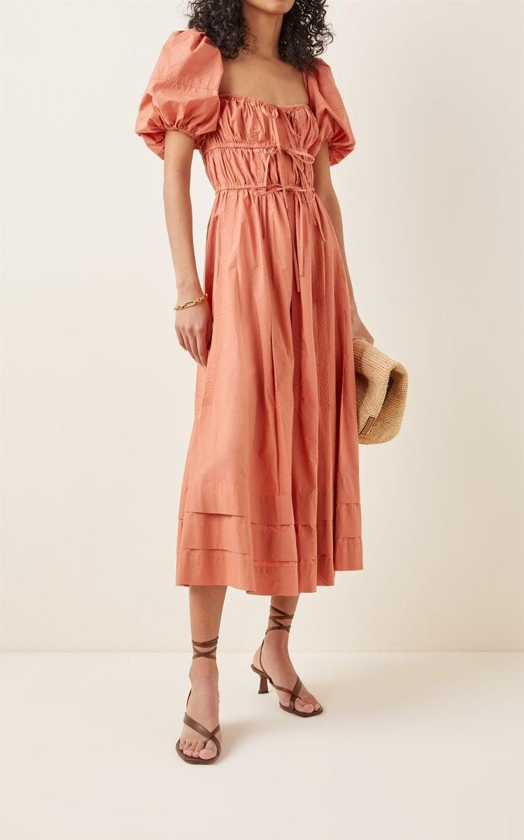 <p>Coral is the sherbet spring color we are here for. It's not too bright, but still packs a punch, and it makes us happy. We're seeing it everywhere, and we are ready for it. This <span>Ulla Johnson Palma Tie-Detail Cotton Midi Dress</span> ($425) is what we want to wear all the time.</p>