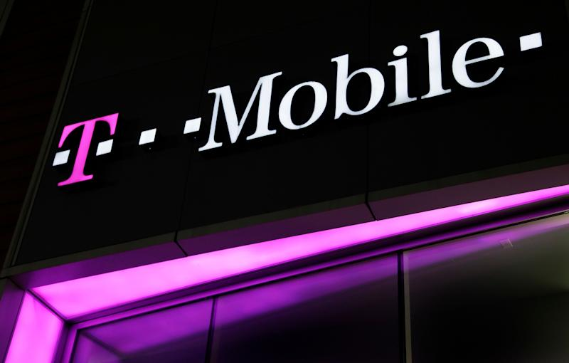 A sign for a T-Mobile store is displayed, Wednesday, Nov. 9, 2011, in New York. T-Mobile is a subsidiary of Deutsche Telekom. New plans at T-Mobile USA helped the struggling No. 4 carrier stabilize its business in the third quarter after dismal results earlier this year. (AP Photo/Mark Lennihan)