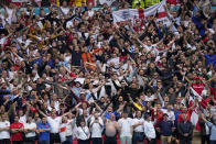 England supporters cheer in the stands before the start of the Euro 2020 soccer championship round of 16 match between England and Germany at Wembley stadium in London, Tuesday, June 29, 2021. Arguably, no country has elevated sport's role in society quite as much as Britain so the absence of crowds for much of the coronavirus pandemic has been a constant reminder, if any were needed, of the cultural toll of COVID-19. The steady return of fans to sports over the past few weeks and the promise of packed-out stadiums very soon provide hope that life is returning to normal in the wake of the rapid rollout of coronavirus vaccines. (AP Photo/Frank Augstein, Pool)