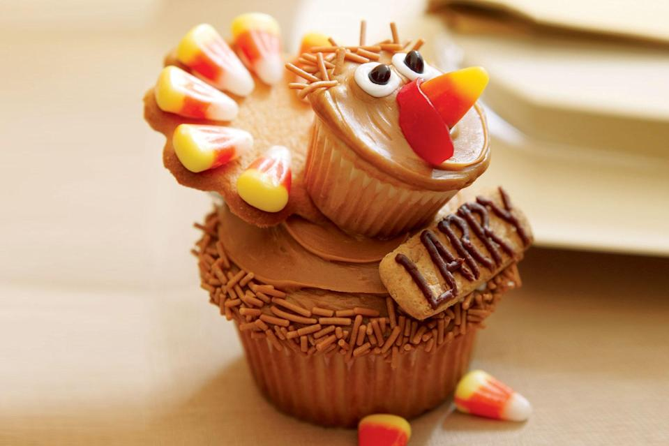 """If you've got kids at home who are looking for a project, these Thanksgiving place card cupcakes are ideal. <a href=""""https://www.epicurious.com/recipes/food/views/turkey-cupcakes?mbid=synd_yahoo_rss"""" rel=""""nofollow noopener"""" target=""""_blank"""" data-ylk=""""slk:See recipe."""" class=""""link rapid-noclick-resp"""">See recipe.</a>"""