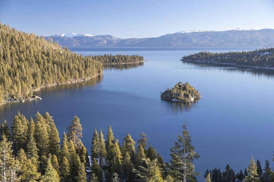 <p>Emerald Bay on <strong>Lake Tahoe</strong> at the border of California and Nevada. Trees surround the water as far as the eyes can see.</p>