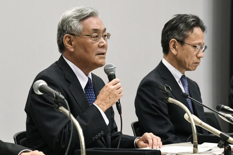 Kansai Electric Power Co. Chairman Makoto Yagi, left, and President Shigeki Iwane attends a press conference in Osaka, western Japan Wednesday, Oct. 9, 2019.  Yagi has resigned over a scandal involving 20 of its executives who received cash and lavish gifts totaling $3 million from a former official in a western Japan town where it operates a nuclear power plant. (Junko Ozaki/Kyodo News via AP)