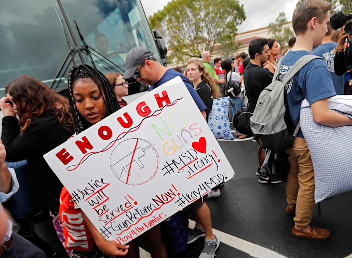 <p>Tyra Hemans, 19, left, and Logan Locke, 17, right, students who survived the shooting at Stoneman Douglas High School, wait to board buses in Parkland, Fla., Tuesday, Feb. 20, 2018. The students plan to hold a rally Wednesday in hopes that it will put pressure on the state's Republican-controlled Legislature to consider a sweeping package of gun-control laws, something some GOP lawmakers said Monday they would consider. ( Photo: Gerald Herbert/AP) </p>