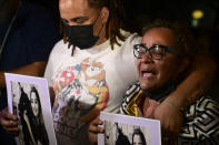 Keila Ortiz, the mother of Keishla Rodriguez, cries out for justice after boxer Felix Verdejo was arrested in connection with the death of her 27-year-old pregnant daughter whose body was found in a lagoon, outside FBI headquarters in San Juan, Puerto Rico, Sunday, May 2, 2021. (AP Photo/Carlos Giusti)