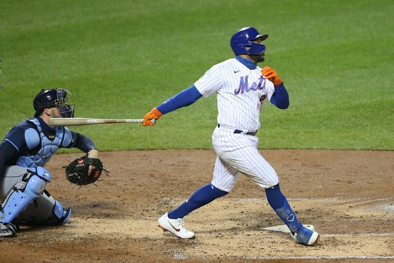 Dominic Smith swings through pitch against Rays