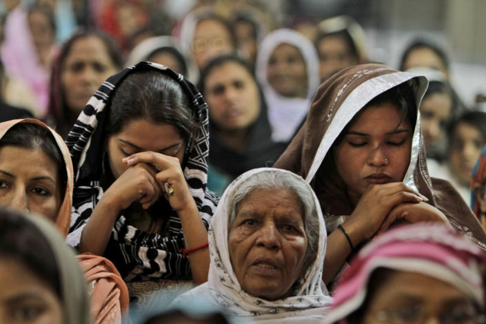 Pakistani Christians pray for the recovery of 14-year-old schoolgirl Malala Yousufzai, who was shot last Tuesday by a Taliban gunman for speaking out in support of education for women, at the Sacred Heart Cathedral Church in Lahore, Pakistan, Sunday, Oct. 14, 2012. The United Arab Emirates plans to send a specialized aircraft to serve as an ambulance for Yousufzai in case doctors decide to send her abroad for treatment, a Pakistani official said Sunday. (AP Photo/K.M. Chaudary)