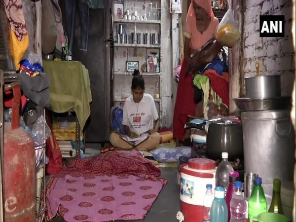 Gunjan, a student of Class 10 in a government school, at her home in Delhi. (Photo/ANI)