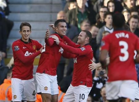 Manchester United's Van Persie celebrates with team-mate Rooney after scoring a goal against Fulham during their English Premier League soccer match at Craven Cottage in London