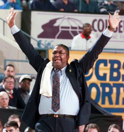FILE - In this March 15, 1996, file photo, Georgetown head coach John Thompson yells to his players during the second half of a first round NCAA college basketball game at the Richmond Coliseum in Richmond, Va. John Thompson, the imposing Hall of Famer who turned Georgetown into a Hoya Paranoia powerhouse and became the first Black coach to lead a team to the NCAA mens basketball championship, has died. He was 78 His death was announced in a family statement Monday., Aug. 31, 2020. No details were disclosed. (AP Photo/Doug Mills, File)