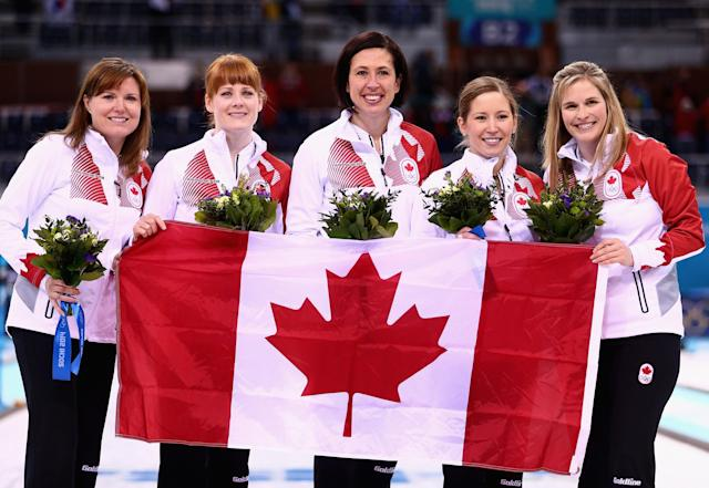 SOCHI, RUSSIA - FEBRUARY 20: Gold medalists Jennifer Jones (R), Kaitlyn Lawes (2nd R), Jill Officer (C), Dawn McEwen (2nd L) and Kirsten Wall (L) of Canada celebrate during the flower ceremony for the Gold medal match between Sweden and Canada on day 13 of the Sochi 2014 Winter Olympics at Ice Cube Curling Center on February 20, 2014 in Sochi, Russia. (Photo by Clive Mason/Getty Images)