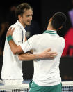 Serbia's Novak Djokovic, right, is congratulated by Russia's Daniil Medvedev, left, after winning the men's singles final at the Australian Open tennis championship in Melbourne, Australia, Sunday, Feb. 21, 2021.(AP Photo/Andy Brownbill)