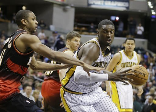 Indiana Pacers' Roy Hibbert (55) goes to the basket against Atlanta Hawks' Al Horford during the second half of an NBA basketball game Monday, March 25, 2013, in Indianapolis. The Pacers defeated the Hawks 100-94. (AP Photo/Darron Cummings)