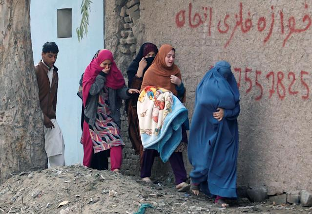 <p>Afghan women leave the site of a blast and gun fire in Jalalabad, Afghanistan, Jan. 24, 2018. (Photo: Parwiz/Reuters) </p>