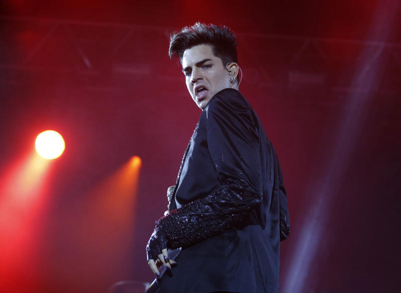 "In this June 30, 2012 file photo, Adam Lambert and the rock group Queen perform in a fan zone during the Euro 2012 soccer championship tournament in Kiev, Ukraine. Lambert is among the various names being tossed around as an ""American Idol"" replacement judge after the exits of judges Steven Tyler and Jennifer Lopez. (AP Photo/Efrem Lukatsky, File)"