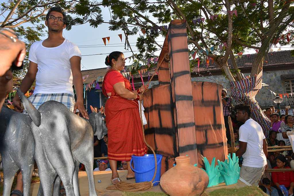 A float depicting an agrarian village scene in Goa.