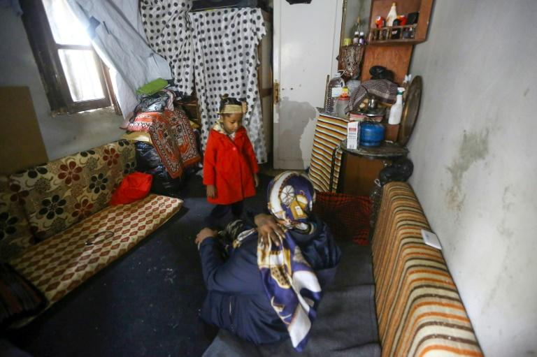 A displaced Libyan woman speaks to her daughter in a room that serves as their impromptu home on a Tripoli building site (AFP Photo/Mahmud TURKIA, Mahmud TURKIA)