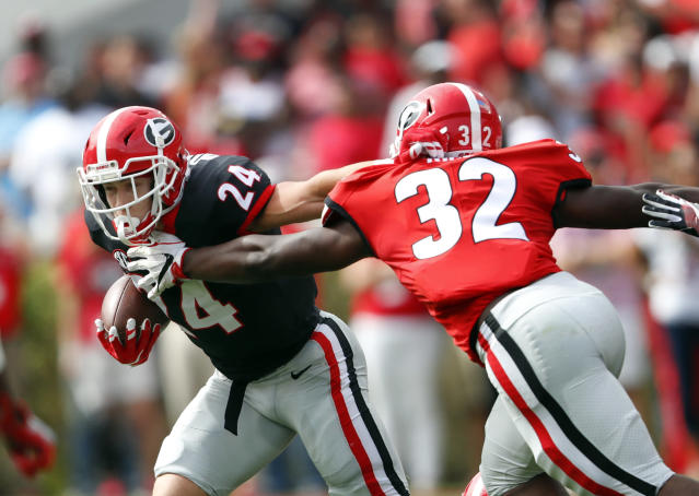 Georgia running back Prather Hudson (24) tries to breaks free from Monty Rice (32) during the first half of the G Day inter squad spring football game Saturday, April 21, 2018, in Athens, Ga. (AP Photo/John Bazemore)