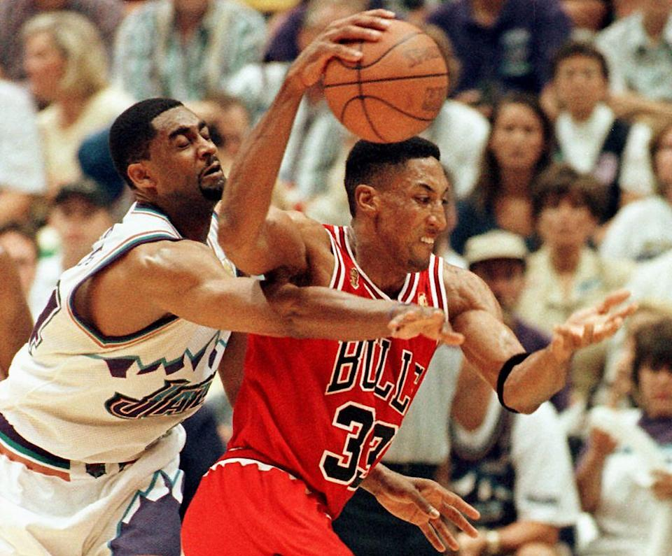 Scottie Pippen (R) of the Chicago Bulls eludes Chris Morris of the Utah Jazz 11 June during game five of the 1997 NBA Finals at the Delta Center in Salt Lake City, Utah. The best of seven series is tied at 2-2.   AFP PHOTO     Paul K. BUCK (Photo by PAUL BUCK / AFP) (Photo by PAUL BUCK/AFP via Getty Images)