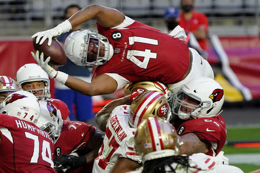 Arizona Cardinals running back Kenyan Drake (41) dives over the line for a touchdown against the San Francisco 49ers during the second half of an NFL football game, Saturday, Dec. 26, 2020, in Glendale, Ariz. (AP Photo/Rick Scuteri)