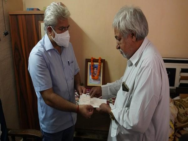 Delhi Revenue Minister Kailash Gahlot on Sunday handed over Rs 1 crore cheque to the family of
