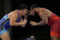 United State's Gable Dan Steveson compete with Mongolia's Lkhagvagerel Munkhtur during the men's 125kg Freestyle wrestling semifinal match at the 2020 Summer Olympics, Thursday, Aug. 5, 2021, in Tokyo, Japan. (AP Photo/Aaron Favila)