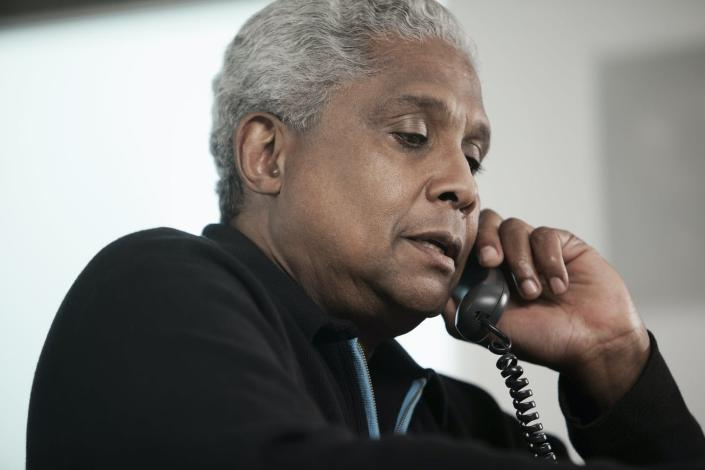 """<span class=""""caption"""">A telephone visit can sometimes work just as well as an online doctor visit.</span> <span class=""""attribution""""><a class=""""link rapid-noclick-resp"""" href=""""https://www.gettyimages.com/detail/photo/black-man-talking-on-telephone-royalty-free-image/150337582?adppopup=true"""" rel=""""nofollow noopener"""" target=""""_blank"""" data-ylk=""""slk:Hill Street Studios via Getty Images"""">Hill Street Studios via Getty Images</a></span>"""