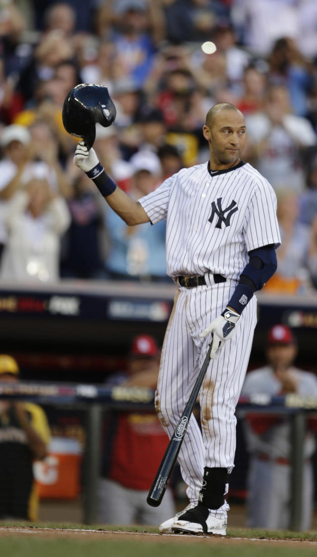 Shortstop Derek Jeter, of the New York Yankees, waves to the crowd during the first inning of the MLB All-Star baseball game, Tuesday, July 15, 2014, in Minneapolis. (AP Photo/Jeff Roberson)