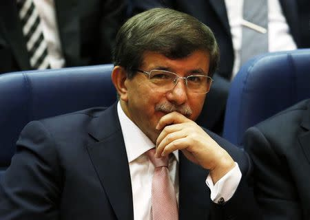 Turkey's Foreign Minister Ahmet Davutoglu attends a meeting at AK Party (AKP) headquarters in Ankara
