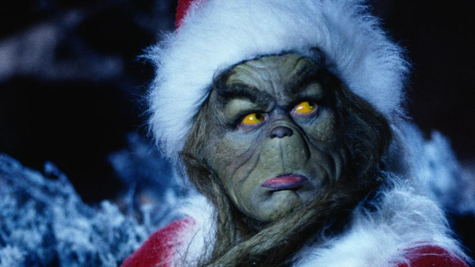 Jim Carrey gurns his way through furry prosthetics in the largely well-loved 'The Grinch', directed by Ron Howard. (Credit: Universal)