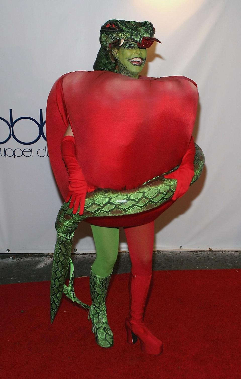 <p>In 2006, Klum appeared as the embodiment of original sin. Serpent-temptress suits her, don't you think? (Photo: Getty Images) </p>