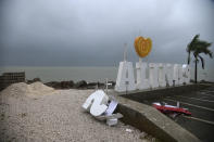 Remnants of a city sign lay on the beach damaged by Tropical Storm Laura in Salinas, Puerto Rico, Saturday, Aug. 22, 2020. Laura began flinging rain across Puerto Rico and the Virgin Islands on Saturday morning and was expected to drench the Dominican Republic, Haiti and parts of Cuba during the day on its westward course. (AP Photo/Carlos Giusti)