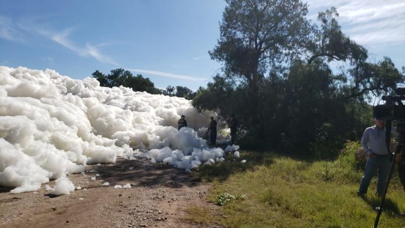 A wall of soap suds formed at Valsequillo reservoir in Puebla, Mexico where a man disappeared. He was taking a photo when he fell in and was later found dead.