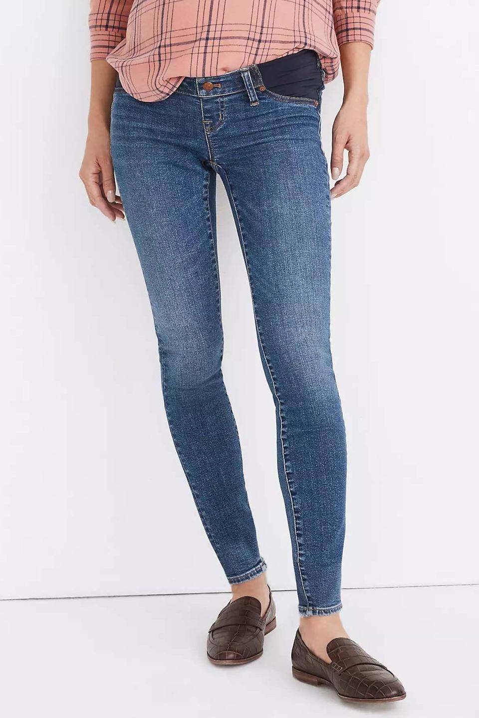"""<p><strong>Madewell</strong></p><p>madewell.com</p><p><strong>$138.00</strong></p><p><a href=""""https://go.redirectingat.com?id=74968X1596630&url=https%3A%2F%2Fwww.madewell.com%2Fmaternity-side-panel-skinny-jeans-in-wendover-wash-adjustable-tenceltrade%253B-denim-edition-MB509.html&sref=https%3A%2F%2Fwww.goodhousekeeping.com%2Fchildrens-products%2Fg34498315%2Fbest-maternity-jeans%2F"""" rel=""""nofollow noopener"""" target=""""_blank"""" data-ylk=""""slk:Shop Now"""" class=""""link rapid-noclick-resp"""">Shop Now</a></p><p>While most jeans are made of cotton, these are blended with <strong>11% <a href=""""https://www.goodhousekeeping.com/clothing/a27560140/what-is-tencel-fabric/"""" rel=""""nofollow noopener"""" target=""""_blank"""" data-ylk=""""slk:TENCEL lyocell"""" class=""""link rapid-noclick-resp"""">TENCEL lyocell</a>, a man-made fiber that uses wood pulp as the raw material and feels incredibly soft and silky.</strong> It has inset panels in the front and a high rise in the back for more coverage. Like some of the other styles, they're stretchy so they are easy to slip on and give a comfortable fit throughout the day.</p>"""