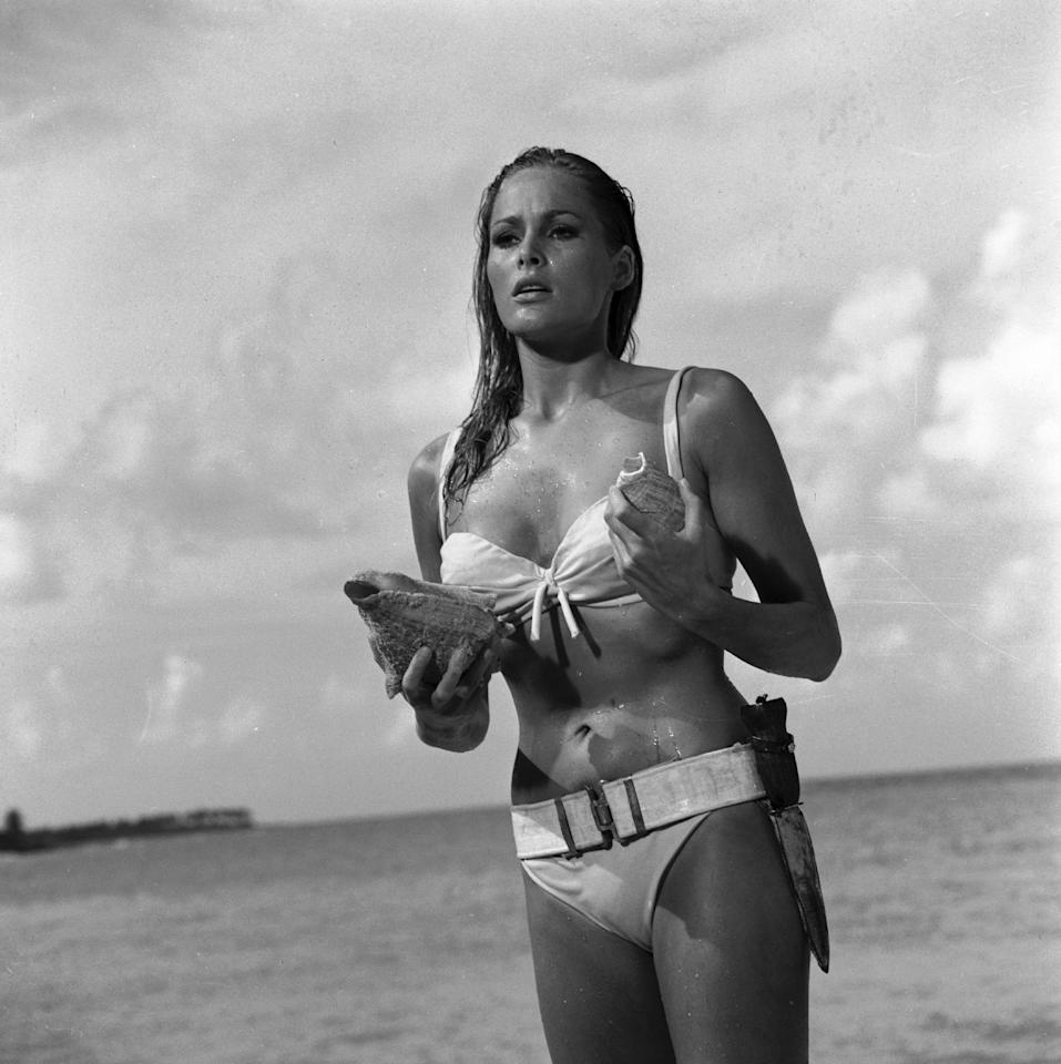 "This undated publicity photo provided by United Artists and Danjaq, LLC shows Ursula Andress in a scene from the James Bond 1962 film, ""Dr. No."" When Ursula Andress emerged from the sea, curves glistening, with a dagger strapped to her bikini in 1962's ""Dr. No,"" she made the Bond girl an instant icon. The film is included in the MGM and 20th Century Fox Home Entertainment Blu-Ray ""Bond 50"" anniversary set. (AP Photo/United Artists and Danjaq, LLC)"