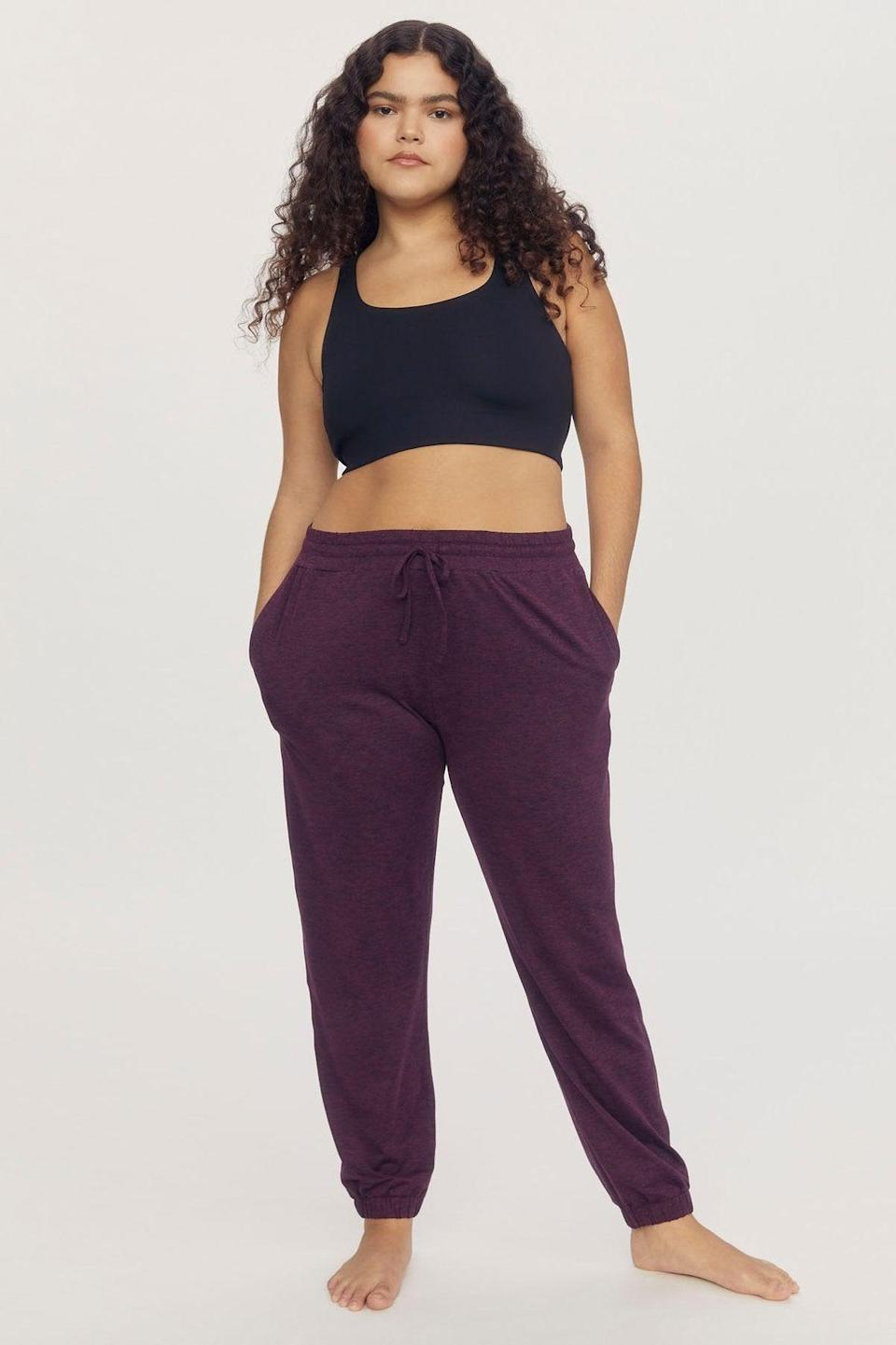 """<br><br><strong>Girlfriend Collective</strong> Plum R&R Jogger, $, available at <a href=""""https://go.skimresources.com/?id=30283X879131&url=https%3A%2F%2Ffave.co%2F3opR9Z3"""" rel=""""nofollow noopener"""" target=""""_blank"""" data-ylk=""""slk:Girlfriend Collective"""" class=""""link rapid-noclick-resp"""">Girlfriend Collective</a>"""