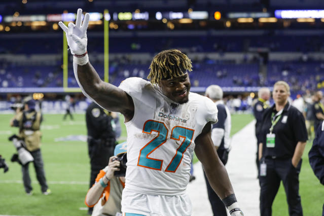 Miami Dolphins running back Kalen Ballage (27) waves to fans as he leaves the field following the team's NFL football game against the Indianapolis Colts in Indianapolis, Sunday, Nov. 10, 2019. The Dolphins defeated the Colts 16-12. (AP Photo/Darron Cummings)