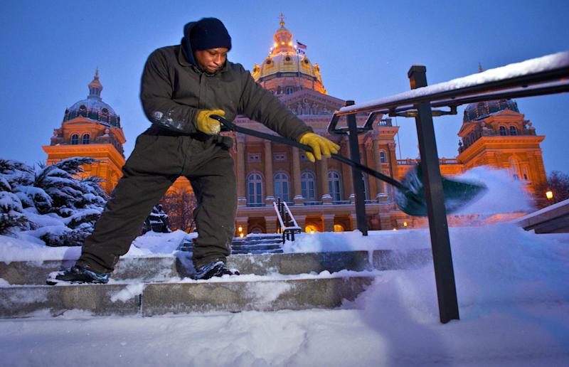 Billie Byrd of Des Moines clears the steps of the Iowa Capitol Friday Feb. 22, 2013, after an overnight snowstorm dumped six inches in Des Moines.  The snowstorm left behind varying amounts of snow and ice across the Midwest, causing difficult travel conditions. Powerful wind gusts created large snow drifts on many roadways, making navigating the slick conditions a challenge.   (AP Photo/The Des Moines Register, Rodney White)