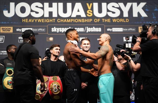 An intense stare down gave way to polite smiles between Anthony Joshua and Oleksandr Usyk at Friday's weigh-in (Zac Goodwin/PA)