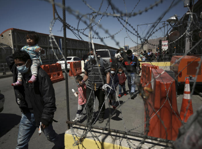 Migrants deported from the U.S. walk into Ciudad Juarez, Mexico, Tuesday, March 23, 2021. Mexico announced that U.S. advisers on border and immigration issues will meet with Mexican officials on Tuesday to discuss migration and development in Central America, as a surge of migrants has hit the U.S. southern border. (AP Photo/Christian Chavez)