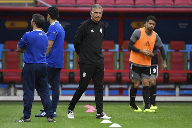 "Coach Carlos Queiroz (C) concedes Iran now face one of the biggest challenges in their World Cup history, but maintains they can ""make the impossible possible"" against Spain (AFP Photo/SAEED KHAN)"