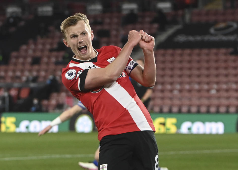 Southampton's James Ward-Prowse celebrates after scoring his side's opening goal during the English Premier League soccer match between Southampton and Leicester City at St. Mary's Stadium in Southampton, England, Friday, April 30, 2021. (Neil Hall/Pool via AP)