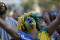 <p>A Brazil soccer fan looks up to heaven as her team is down by two goals at halftime, as she watches a live telecast of the Brazil vs. Belgium World Cup quarter finals soccer match, in Rio de Janeiro, Brazil, Friday, July 6, 2018. (AP Photo/Silvia Izquierdo) </p>
