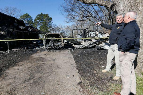 PHOTO: Officials from the Mississippi Fire Marshal's office, confer outside the scene of a fatal fire, Feb. 8, 2020 in Clinton, Miss. (Rogelio V. Solis/AP)