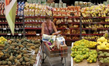 FILE PHOTO: A consumer shops at a supermarket in Sao Paulo