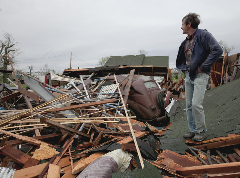Gary Gladwin looks over his wrecked property where he stored a 1937 Chevy, in Thurman, Iowa, Sunday, April 15, 2012. A large part of the town in the western part of the state was destroyed Saturday night, possibly by a tornado, but no one was injured or killed. Fremont County Emergency Management Director Mike Crecelius said about 75 percent of the 250-person town was destroyed. (AP Photo/Nati Harnik)