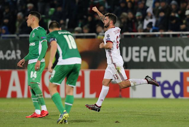 Soccer Football - Europa League Round of 32 First Leg - PFC Ludogorets Razgrad vs AC Milan - Ludogorets Arena, Razgrad, Bulgaria - February 15, 2018 AC Milan's Patrick Cutrone celebrates scoring their first goal as Ludogorets' Marcelinho looks dejected REUTERS/Stoyan Nenov